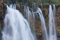 8/2/09 Havasupai-- Water flows from Fifty Foot Falls, one of the the Havasupai waterfalls. A flash flood in August of 2008 made the waterfall bigger. (Pat Shannahan/ The Arizona Republic)