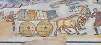 Ambulatory of the Great Hunt Roman mosaic, Wagons being pulled by bullocks, room no 28, at the Villa Romana del Casale, first quarter of the 4th century AD. Sicily, Italy. A UNESCO World Heritage Site.<br /> <br /> The Great Hunt ambulatory is around 60 meters long (200 Roman feet) and connects the master&rsquo;s northern apartments with the triclinium in the south. The door in the centre of the the Great Hunt ambulatory leads to audience hall. <br /> <br /> The Great Hunt Roman mosaic depicts African animals being hunted and put onto ships to be taken to the Colosseum.