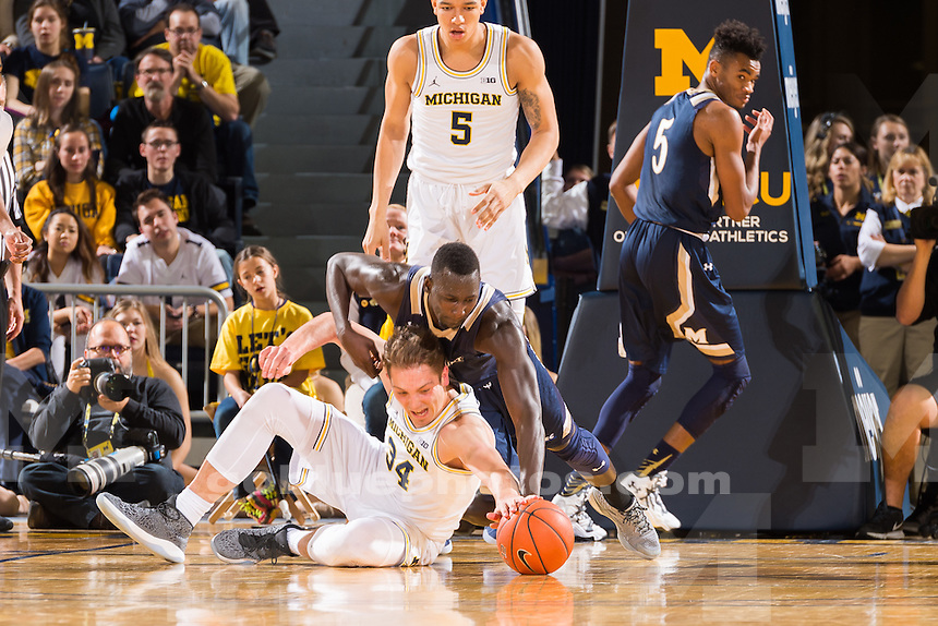The University of Michigan men's basketball team,64-47 victory over Mount St. Mary at the Crister Center in Ann Arbor, MI. on November 26, 2016.