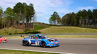 Racing under blue sky and fluffy clouds, Barber Motorsports Park, Leeds, AL. (Photo by Brian Cleary/www.bcpix.com)