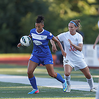 Boston Breakers forward Lianne Sanderson (10) controls the ball as FC Kansas City midfielder Lauren Holiday (12) pressures. In a National Women's Soccer League (NWSL) match, Boston Breakers (blue) defeated FC Kansas City (white), 1-0, at Dilboy Stadium on August 10, 2013.