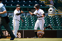 Bradenton Marauders right fielder Kevin Krause (6) is congratulated as he rounds third base after hitting a home run in the bottom of the fourth inning during a game against the Charlotte Stone Crabs on April 9, 2017 at LECOM Park in Bradenton, Florida.  Bradenton defeated Charlotte 5-0.  (Mike Janes/Four Seam Images)