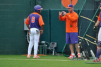 First-year head coach Monte Lee (18) of the Clemson Tigers works with Jordan Greene in a fall practice intra-squad Orange-Purple scrimmage on Sunday, September 27, 2015, at Doug Kingsmore Stadium in Clemson, South Carolina. (Tom Priddy/Four Seam Images)