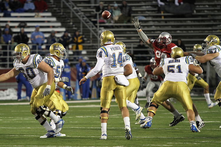 UCLA quarterback, Kevin Prince (#14), fires a pass over the middle behind great protection from the Bruin offensive line during UCLA's 43-7 Pac-10 conference road victory over Washington State at Martin Stadium in Pullman, Washington, on November 14, 2009.