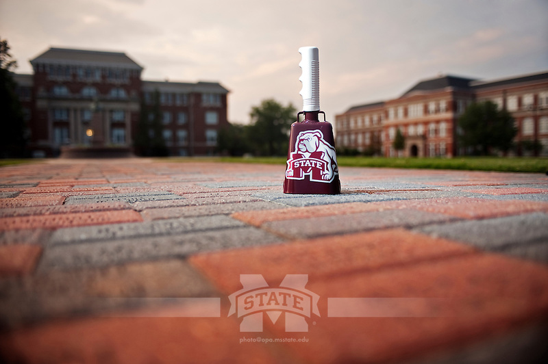 Cowbell with spotlight on Drill Field Walk of Honor (photo by Megan Bean / © Mississippi State University)