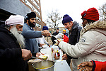 ROCKAWAY PARK, NEW YORK-NOVEMBER 01: Members of the Gurdwara Sikh Temple Society hand out food to residents of this Queens neighborhood after Hurricane Sandy November 1, 2012. The Rockaways have been devastated by the storm with many homes destroyed and many residents without power.