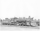 Engineer side view of D&amp;RGW #484 K-36 with plow on pilotand #499 K-37 in background.<br /> D&amp;RGW  Alamosa, CO  Taken by Payne, Andy M. - 8/22/1954