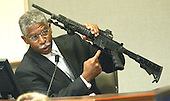 Bureau of Alcohol, Tobacco, and Firearms (ATF) agent Walter A. Dandridge Jr., holds the bushmaster rifle used in the sniper shootings during his testimony during the trial of Sniper Suspect John Allen Muhammad in Virginia Beach Circuit Court in Virginia Beach, Virginia, November 6, 2003. <br /> Credit: Tracy Woodward - Pool via CNP