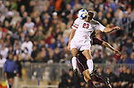 14 December 2007: Ohio State's Eric Brunner (23) outjumps Massachusetts' Bryan Hogan (behind) and heads the ball. The Ohio State University Buckeyes defeated the University of Massachusetts Minutemen 1-0 at SAS Stadium in Cary, North Carolina in a NCAA Division I Mens College Cup semifinal game.