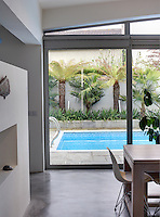 The swimming pool is situated on a terrace beyond the kitchen-diner and is accessed through large sliding glass doors