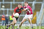 Paul O'Connor Kenmare goes past Eamon O'Callaghan Rockchapel during their Munster Club Champiionship semi final in Fitzgerald Stadlium on Sunday