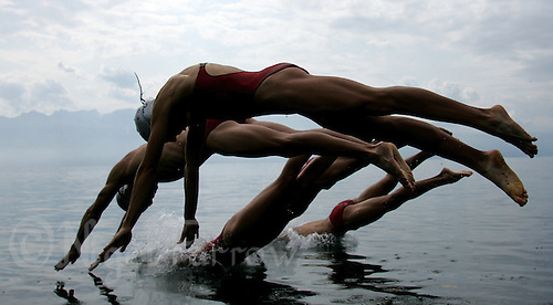 19 AUG 2005 - LAUSANNE, SWITZERLAND - Portuguese team members practise their swimstart before the European Triathlon Championships. (PHOTO (C) NIGEL FARROW)