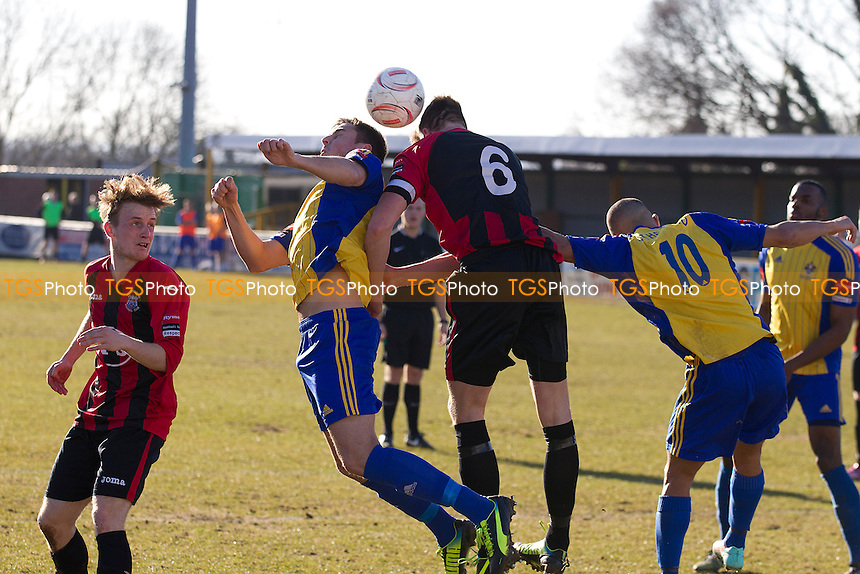 Plenty of pushing as Joe Scott attempts to get on the end of a first half corner for Romford - Romford vs Chatham Town - Ryman League Division One North Football at the Thurrock FC, Ship Lane - 07/03/15 - MANDATORY CREDIT: Ray Lawrence/TGSPHOTO - Self billing applies where appropriate - contact@tgsphoto.co.uk - NO UNPAID USE