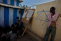 """Jewish children attend sunday school at a school funded by a foreign non governmental organization in the city of Gonder in northern Ethiopia where 9000 so called """"Falash Mura"""" now live on Sunday january 11 2009...Gonder hosts a population of around 9000 so called """"Falash Mura"""", supposed Ethiopian Jews who were forced to convert to Christianity. The Israeli Government is still verifying their claims  and if a clear link between them and Israel would be established they would have the right to return to their mother land. In the mean time Israeli and other Jewish non governmental organizations are working in support of this community."""
