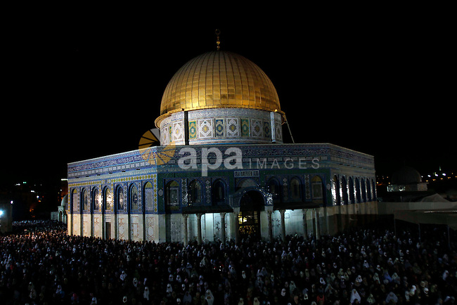 Palestinian Muslim worshippers pray during Laylat Al Qadr, also known as the Night of Power, in front of the Dome of the Rock Mosque, in the Al Aqsa Mosque compound in Jerusalem's Old City, Tuesday Aug 14,2012. Laylat Al Qadr is marked on the 27th day of the holy fasting month of Ramadan. Photo by Issam Rimawi