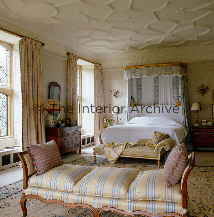 The master bedroom has kept its original Jacobean plasterwork ceiling and frieze