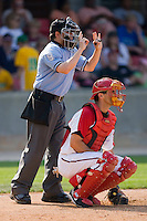 Home plate umpire Gerard Ascani signals a 3-2 count during a Southern League game between the Jacksonville Suns and the Carolina Mudcats at Five County Stadium May 16, 2010, in Zebulon, North Carolina.  Photo by Brian Westerholt /  Seam Images
