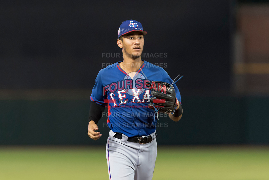 AZL Rangers centerfielder Obie Ricumstrict (24) jogs off the field between innings of an Arizona League game against the AZL Giants Black at Scottsdale Stadium on August 4, 2018 in Scottsdale, Arizona. The AZL Giants Black defeated the AZL Rangers by a score of 6-3 in the second game of a doubleheader. (Zachary Lucy/Four Seam Images)