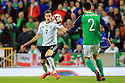 Northern Ireland's  Conor McLaughlin clashes with Germany's Julian Draxler during the FIFA World Cup 2018 Qualifying Group C qualifying soccer match between Northern Ireland and Germany at the National Football Stadium at Windsor Park, Belfast, Northern Ireland, 5 Oct 2017.  Germany beat Northern Ireland 3-1. Photo/Paul McErlane