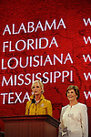 Wife of Republican presidential nominee Cindy McCain encourages delegates to donate to hurricane relief efforts as First Lady Laura Bush stands beside her on day one of the Republican National Convention at the XCel Center in Saint Paul, Minnesota on September 1, 2008.  Convention activities have been scaled back considerably on day one due to Hurricane Gustav.