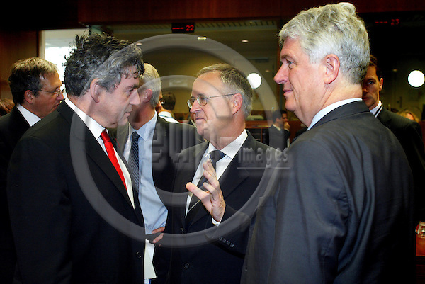 BRUSSELS - BELGIUM - 08 NOVEMBER 2005 -- ECOFIN Council meeting -- From left Gordon BROWN, Chancellor of the Exchequer, UK, and the President of the Council, speaking with his German counterpart Hans EICHEL and Caio KOCK-WESSER, President for Economic and Financial Committee (EFC).  PHOTO: ERIK LUNTANG / EUP-IMAGES..