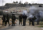 Israeli soldiers fire tear gas towards Palestinian protesters during clashes that broke out at a weekly demonstration against Israeli-occupation in the northern West Bank village of Kfar Kadum on December 9, 2011. A Palestinian was critically wounded when he was hit in the face by a tear gas canister fired by Israeli troops at a rally in Nabi Saleh, some 10 kilometres (six miles) northwest of Ramallah, medics and witnesses said. Photo by Wagdi Eshtayah.