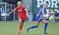 Portland, Oregon - Sunday September 4, 2016: Portland Thorns FC midfielder Lindsey Horan (7) shoots the ball past Boston Breakers defender Kassey Kallman (5) during a regular season National Women's Soccer League (NWSL) match at Providence Park.