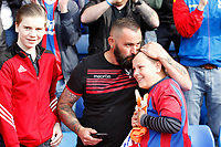 A delighted Crystal Palace fan is handed the gloves of Wayne Hennessey during the EPL - Premier League match between Crystal Palace and West Bromwich Albion at Selhurst Park, London, England on 13 May 2018. Photo by Carlton Myrie / PRiME Media Images.