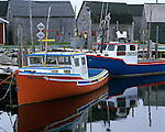 Queens County, Nova Scotia<br /> Colorful fishing boats docked at the wharf near West Berlin