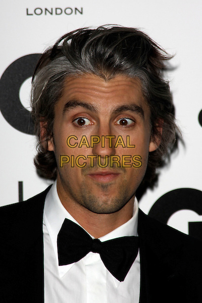 GEORGE LAMB.The GQ Men of The Year Awards held at The Royal Opera House, Covent Garden, London, England, UK..September 7th 2010.headshot portrait black white bow tie wide eyes funny .CAP/AH.©Adam Houghton/Capital Pictures.