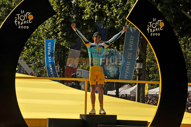 Overall race Yellow Jersey winner Alberto Contador (ESP) Astana on he podium at the end of the final Stage 21 of the 2009 Tour de France running 164km from Montereau-Fault-Yonne to Paris Champs-Elysees, France. 26th July 2009 (Photo by Eoin Clarke/NEWSFILE)