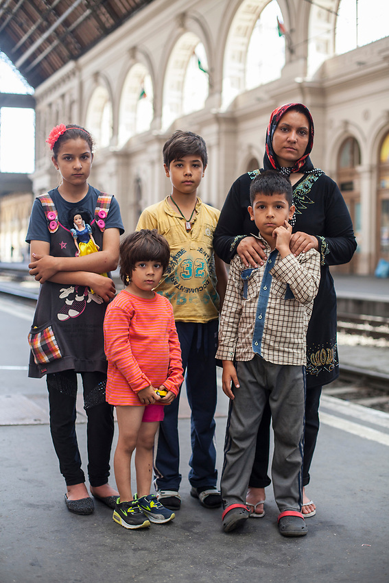 Afghan family mum Somaye Hosseini with her children left to right  Sina, 10 years old,Sarina, 4, Hadisseh 11, and Hossein 7 .