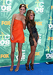 Actresses Jessica Stroup and Shenae Grimes arrive at the 2008 Teen Choice Awards at the Gibson Amphitheater on August 3, 2008 in Universal City, California.