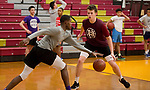 WATERBURY, CT-120618JS13-Sacred Heart's Nate Tabor, left, looks to drive past teammate Connor Tierney while running through drills during practice Thursday at Alumni Hall. <br />