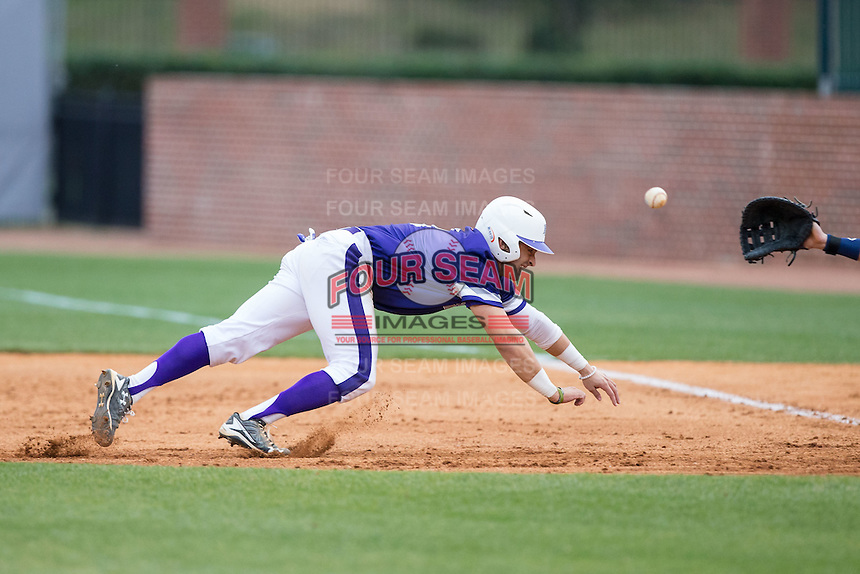 Tim Mansfield (3) of the High Point Panthers tries to beat a pick-off throw back to first base during game two of a double-header against the NJIT Highlanders at Williard Stadium on February 18, 2017 in High Point, North Carolina.  The Highlanders defeated the Panthers 4-2.  (Brian Westerholt/Four Seam Images)