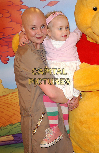 "GAIL PORTER & DAUGHTER HONEY HIPGRAVE.join Winnie the Pooh at the Disney Store on Oxford Street for Disney's ""Cuddle Day"" launched to celebrate Winnie the Pooh's 80th birthday, London, England, .26th April 2006..half length mother mum family costume  bear character dressed-up bald no hair.Ref: BEL.www.capitalpictures.com.sales@capitalpictures.com.©Tom Belcher/Capital Pictures."