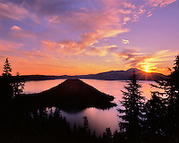 Sunrise at Crater Lake over Wizard Island in Crater lake National Park, Oregon