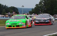 Aug. 8, 2009; Watkins Glen, NY, USA; NASCAR Nationwide Series driver Brad Keselowski (88) leads Justin Allgaier (12) during the Zippo 200 at Watkins Glen International. Mandatory Credit: Mark J. Rebilas-