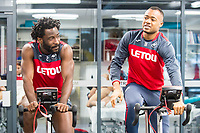 (L-R) Wilfried Bony and Jordan Ayew exercise in the gym during the Swansea City training session at The Fairwood training Ground, Swansea, Wales, UK. Thursday 16 November 2017