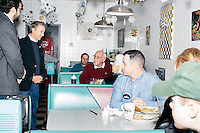 Kentucky senator and Republican presidential candidate Rand Paul greets people in Norton's Classic Cafe in Nashua, New Hampshire. After the diner stop, campaign volunteers canvassed Nashua-area neighborhoods.