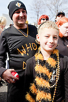 James Phillips, front, and Keith Pichoff at a parade in Buddy D's honor on January 31, 2010 in New Orleans.<br /> <br /> Thousands of Saints fans wearing dresses paraded from the Louisiana Superdome to the French Quarter to honor a promise made by the late sportscaster and Saints super-fan Buddy Diliberto aka &quot;Buddy D&quot;.<br /> <br /> In 1993 Buddy D, who passed away in 2005, remarked on air that if the Saints were to make it to the Super Bowl, he would wear a dress and dance down the streets.  The comment was repeated at various times and never forgotten by his listeners.<br /> <br /> Led by former New Orleans Saints quarterback Bobby Hebert, who has taken Buddy D's place on WWL radio, thousands made good on his promise for him, dancing, drinking, and cavorting their way down the street, alternately yelling out &quot;Who Dat!&quot; and &quot;Buddy D!&quot; in front of an onlooking crowd an estimated 85,000 people strong.<br /> <br /> The hard luck NFL team the New Orleans Saints has reached its first Super Bowl in team history, after 43 years largely filled with losing seasons and futility.  It is difficult to travel anywhere in the area without some reminder of this fact, as the team and city are intertwined perhaps like no other sports franchise in this country.