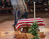 December 5, 2018 - Washington, DC, United States: Former President George W. Bush touches the casket of his father aftervproviding a eulogy at the state funeral service for his father, former President George W. Bush at the National Cathedral.  <br /> Credit: Chris Kleponis / Pool via CNP