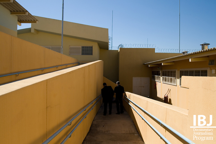 Defense attourneys walk down the aisle at a detention center for youth between the ages of 12-15 in Divinopolis, Brazil. a prison for adolescents where the staff is keen to reduce the presence of guards and relies more on recorded video for supervision. IBJ Fellow Dr. Saliba is programming educational materials for local communities to inform them of their rights to habeas corpus.