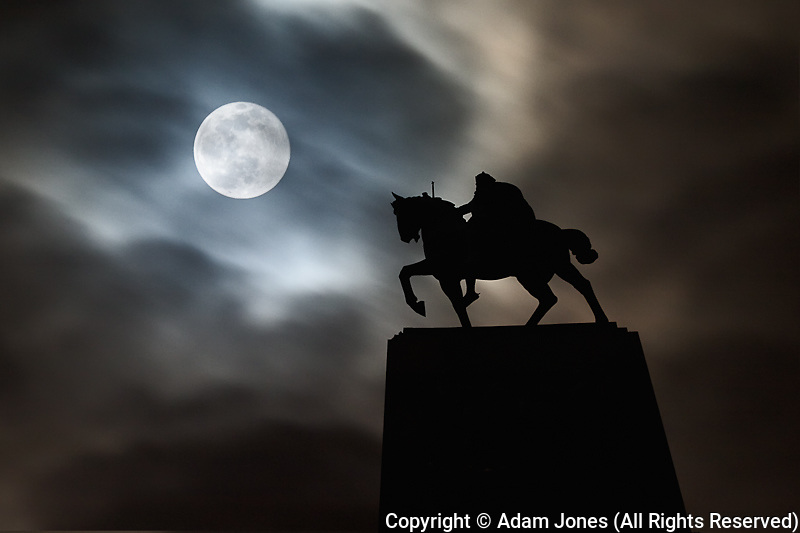 Statue of King Kralja Tomislava silhouetted against full moon, Zagreb, Croatia (Digital Composite)