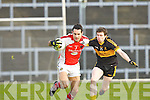 Tom O'Sullivan Rathmore is tracked  by Jamie Doolan Crokes during the O'Donoghue Cup final in Fitzgerald Stadium on Sunday