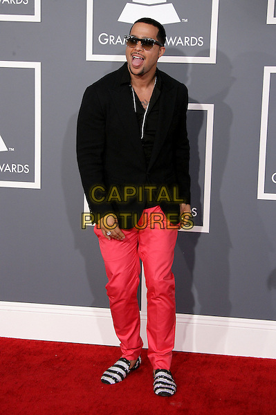 SkyBlu (Skyler Austen Gordy) of LMFAO.The 55th Annual GRAMMY Awards held at STAPLES Center, Los Angeles, California, USA..February 10th, 2013.grammys full length red black pink jeans denim jacket sunglasses shades mouth open silver stripe shoes .CAP/ADM.©AdMedia/Capital Pictures.