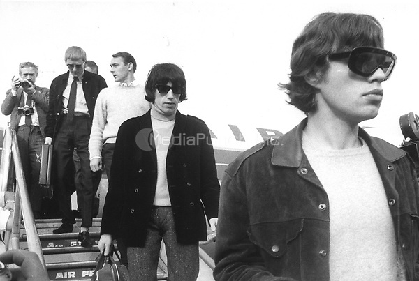 "Mick Jagger (front) and Bill Wyman (2nd R) from the British rock band ""The Rolling Stones"" are arriving at the Airport Berlin Tegel in West Berlin, West Germany on 15.09.1965. 