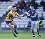 Adam O Connor of  Clare  in action against Billy Murphy of  Tipperary during their Munster Minor football semi-final at Thurles. Photograph by John Kelly.