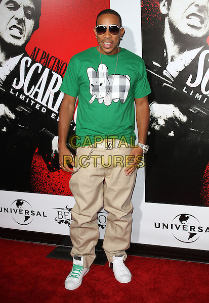 "CHRIS ""LUDACRIS"" BRIDGES.""Scarface"" Blu-Ray DVD Release Party Held at Belasco Theatre, Los Angeles, California, USA..August 23rd, 2011.full length beige trouser green t-shirt gingham white grey gray rabbit bunny print sunglasses shades shoelaces .CAP/ADM/KB.©Kevan Brooks/AdMedia/Capital Pictures."