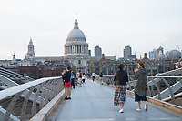 23rd April 2020; London, United Kingdom; People clap and take part in the ClapForCarers event to thank NHS staff on the Millennium Bridge, London, England, UK on Thursday 23 April